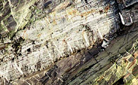 Banded tuff-turbidite with Alpine fissure-veins, Cwmorthin, N Wales